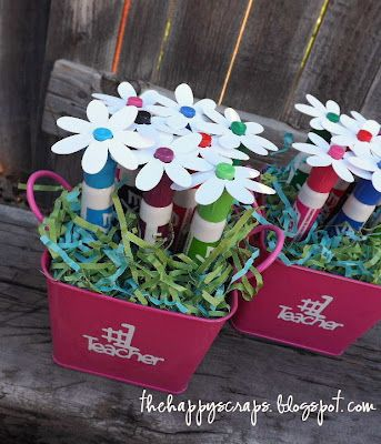 My daughter and I made something very similiar to this for a year end gift for her preschool teacher. Except instead of white flowers on dry erase markers - I used glittered, foam flower stickers on pencils and markers. I should have taken a picture. I set the flower pens into a glass vase that was filled with glass stones.
