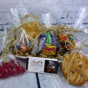 """This hamper includes two bags of yummy lollies, chuppa chups, two scrummy jumbo cookies, one bar of dark chocolate and a bag of """"favourites"""", your choice of a personalised card and your own message.  http://littlepressie.com.au/store/premium-goody-hamper/"""