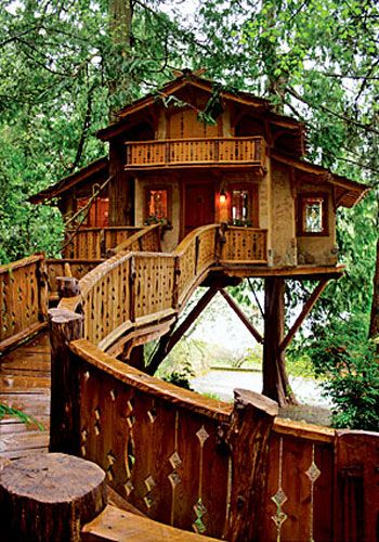 "Heidi's Treehouse Chalet, Poulsbo, Wash. Nelson describes this 450-square-foot treehouse as a ""chalet-style fairy-tale aerie."" The owner especially loves that a ramp, rather than the traditional ladder or stairs, lead to the house."