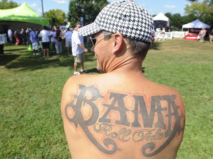 An Alabama fan sports a Bama tattoo on his back before the Alabama Florida game in Tuscaloosa, Ala. on Saturday September 20,  2014.
