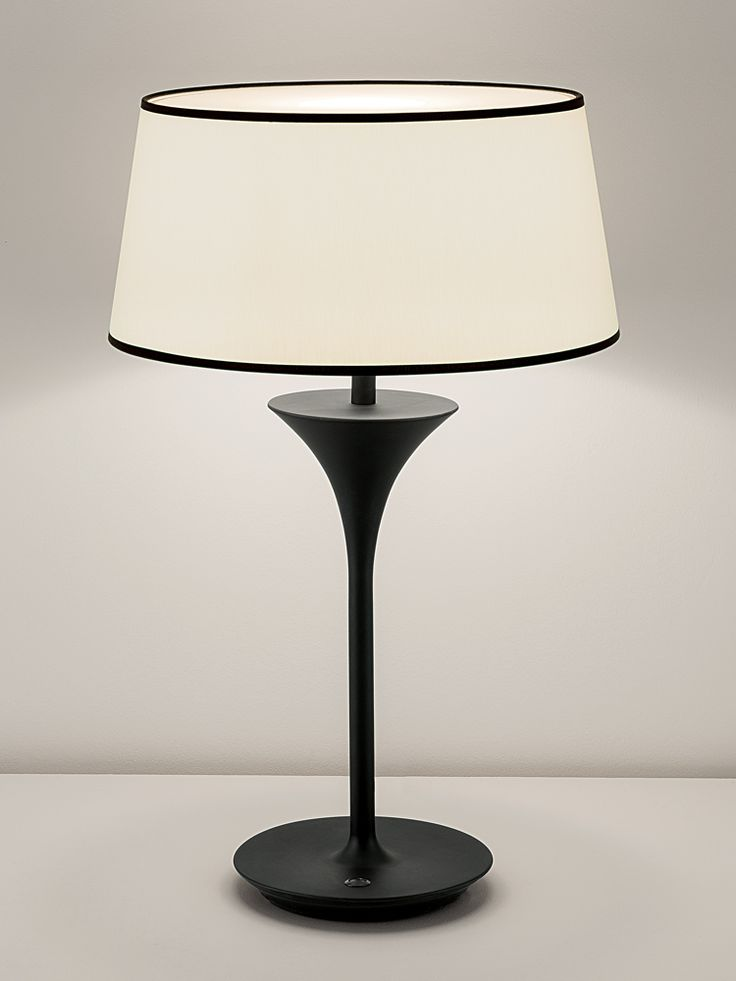 Portable fixturestablethis lamp is used as task lighting for reading your book in your chair