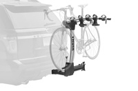 Thule hitch mounted bike rack that swings out of the way.