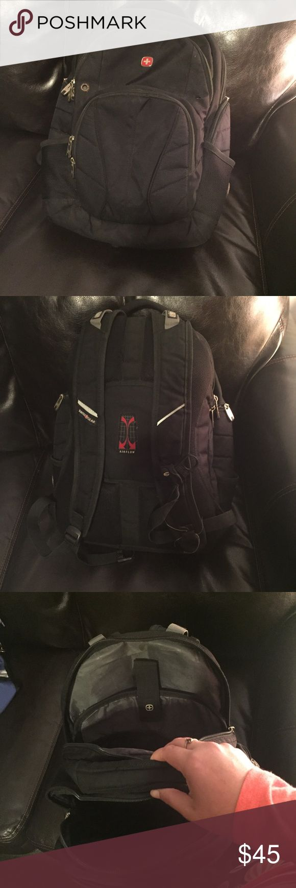 SWISSGEAR Black Backpack. Laptop sleeve. Black Back Pack . Swiss gear. Classic. Zippers a slight  tiny discoloration Spots. Not very noticeable at all. still looks and functions great!  a dime size of the cushion on the back is missing . Super smooth sliding zippers. SwissGear Bags Backpacks