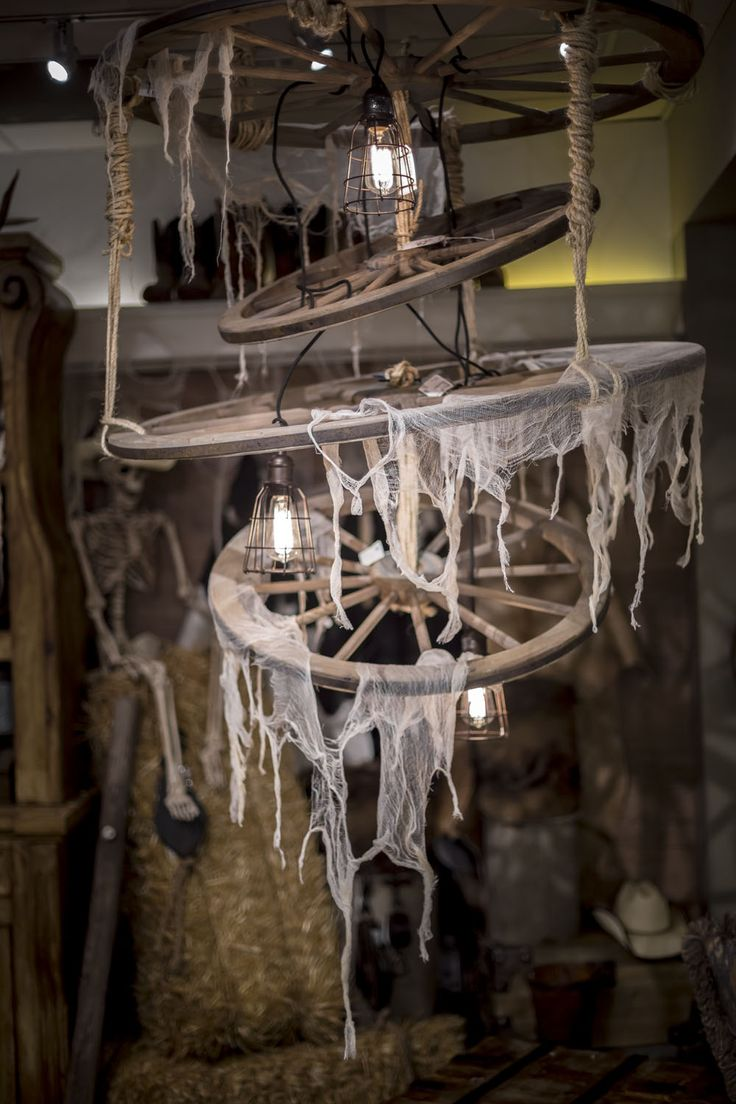 52 best wagon wheel images on pinterest wagon wheels for the revel in the re purposed wagon wheel chandelier as it transports light around the room arubaitofo Gallery