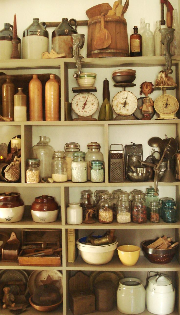 Crocks, firkins, and vintage kitchen items such as canning jars, mashers, butter paddles, butter molds and rolling pins fill this make-shift pantry.