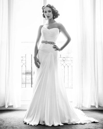 Florence - Our ultimate flattering line with a floaty 'A' line skirt and a hip skimming bodice of asymmetric ruched silk chiffon which perfectly balances curves. Wear it with a glamorous diamante belt (as shown) or soften the look with a silk corsage.