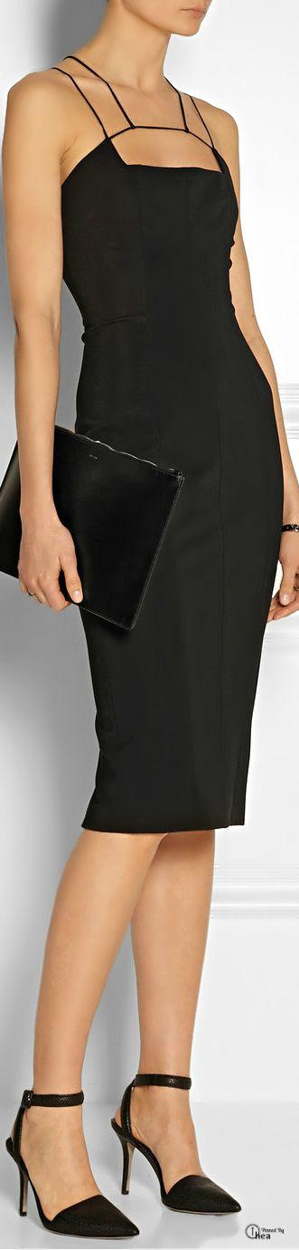 Thin strappy little black dress with geometric neckline, thin ankle strap, pointed black stilettos.