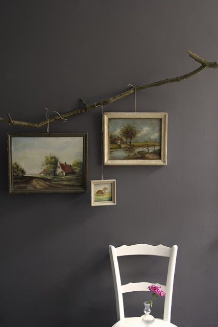 Very unique way to hang pictures. I haven't seen this before. #DIYDriftwood
