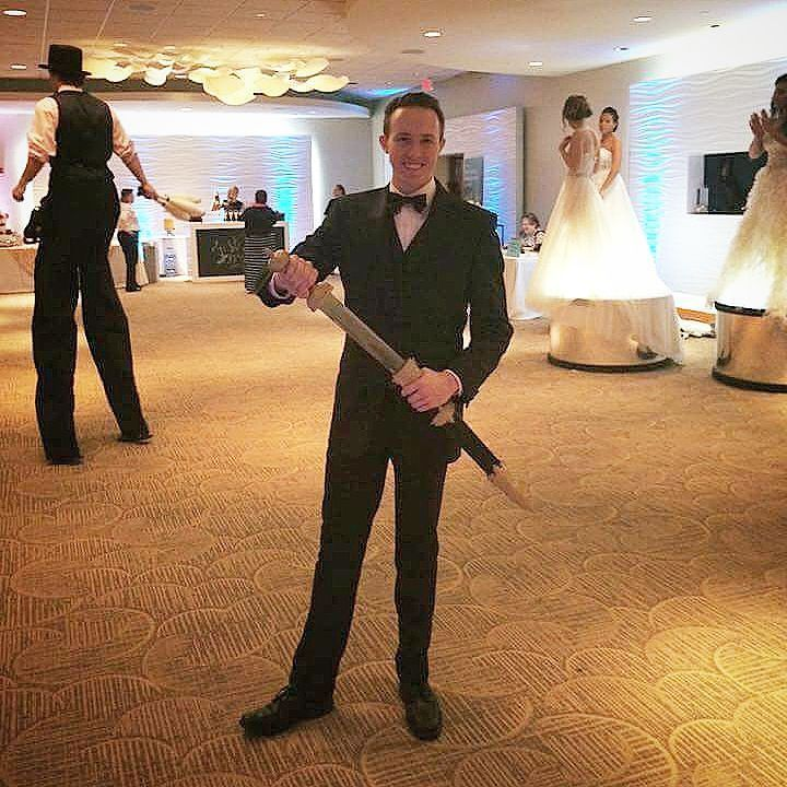 Looking for wedding entertainment? How about someone to slice open champagne with a sword? We have an amazing champagne saber artist! #wedding #champagne #alcohol #bride #groom #bridesmaids #fun #entertainment #sword #saber #cut #handsome #weddingparty #bridal #bridalshow #bridalshower #weddingdress #weddingexpo #cincinnaticircus