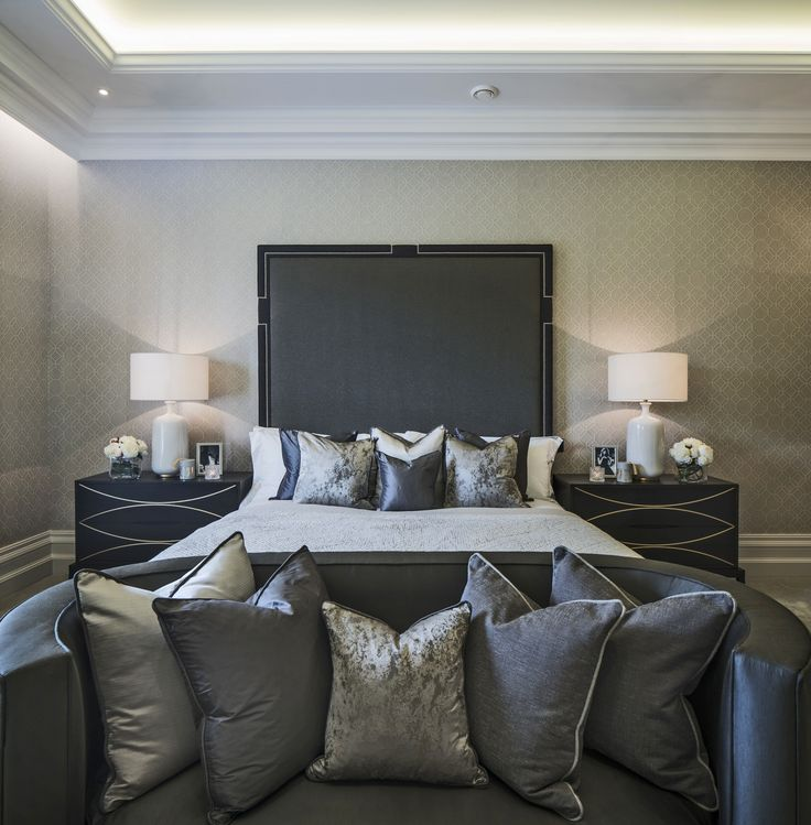 Emitting a sense of luxury through dark grey tones, our elegant bedroom design is completed by these beautiful Robert Langford bedside tables in rich solid oak and lavish cushion fabrics by Zimmer and Rohde and James Hare fabric.