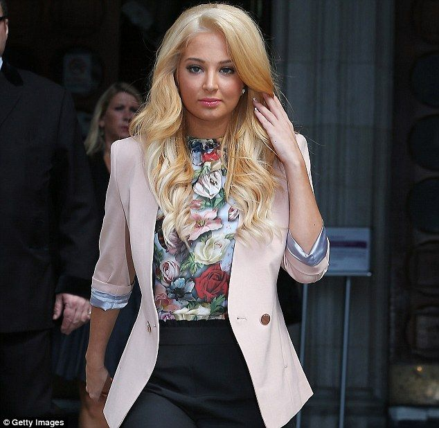 'This time, Justin messed with the wrong woman': Tulisa Contostavlos gave a statement to reporters outside the High Court today after settling her legal action against ex boyfriend Justin Edwards over the publication of a sex tape of the couple