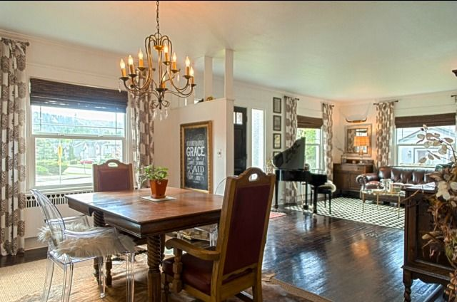 Lucite dining chairs. Cowhide Rug. Mini Baby Grand Piano.