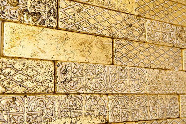 Casanova Collection. Unique production techniques allow for gold leaf to be layered into the tiles, creating a deep sense of luxury.