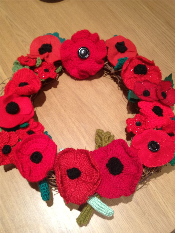 Make a knitted or crochet poppy with our free pattern and wreath-making guide to commemorate those who gave their lives in war
