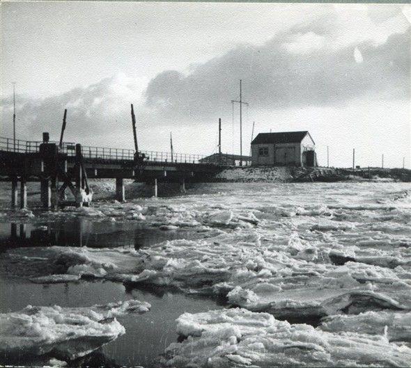 Benfleet Creek, between Benfleet and Canvey Island, Essex, England, 1940. The bridge looking south towards Canvey; the creek partially frozen.