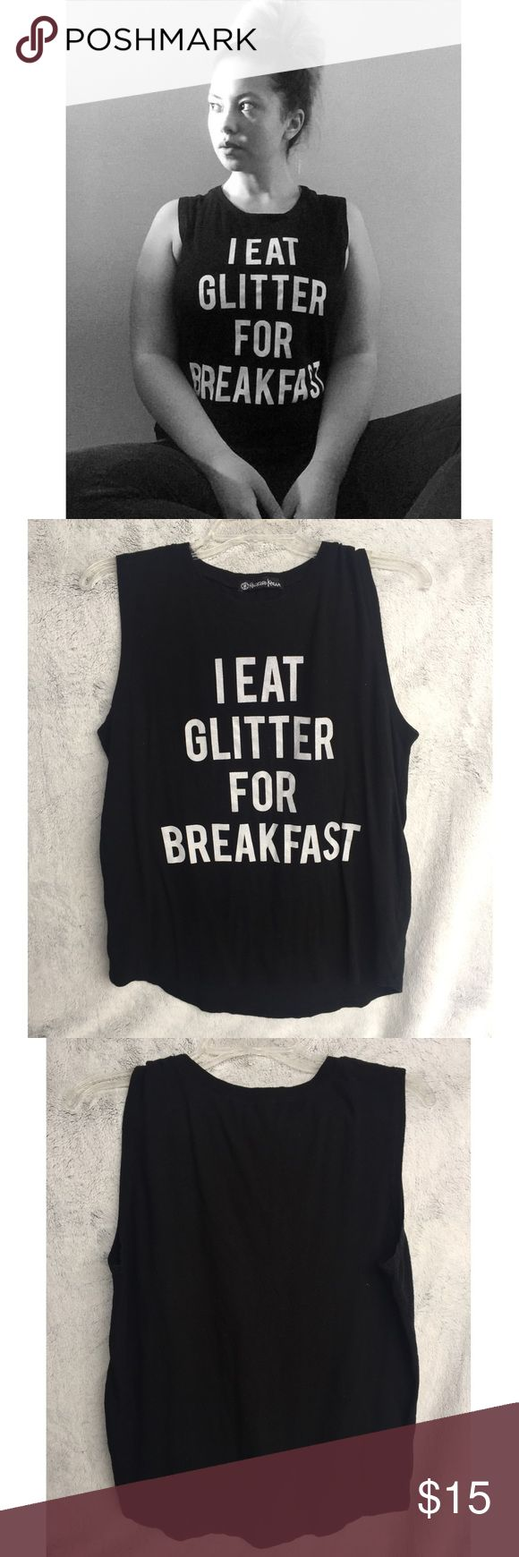 """-new- """"I eat glitter for breakfast"""" Muscle Tank A great workout top or every day tank! Great used condition.   ✔️If you'd like to MAKE AN OFFER please do so through the offer button ONLY. I won't negotiate prices in the comments.  ✔️All sale items, items $15 and under, & clearance items are firm unless BUNDLED.  ❌No trades, PayPal, Holds 📷Instagram: @lovelionessie Tops Tank Tops"""