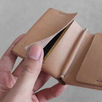 Construct from a single piece of vegetable tanned leather; fold and sew into a minimal bifold wallet.