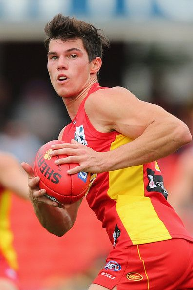Jaeger O'Meara of the Suns runs the ball during the round 14 AFL match between the Gold Coast Suns and the Adelaide Crows at Metricon Stadium on June 29, 2013 in Gold Coast, Australia. http://footyboys.com