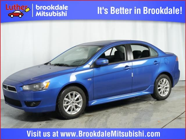 New 2015 Mitsubishi Lancer For Sale in Brooklyn Center MN at Luther Brookdale Mitsubishi dealer MN. Blue sedan. Mitsubishi for sale. New Mitsubishi for sale. Minnesota. Minneapolis. St. Paul. Golden Valley.