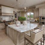 Calacatta marble island kitchen beach style with range hoods range hoods