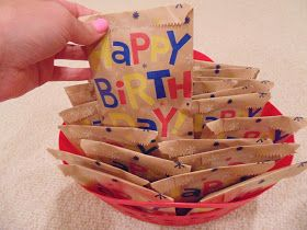 Birthday Bags-A Bright Idea! (it's kind of birthday-in-a-bag for each student: sticker sheet, party blower, smarties, balloon, bookmark)  Cute idea