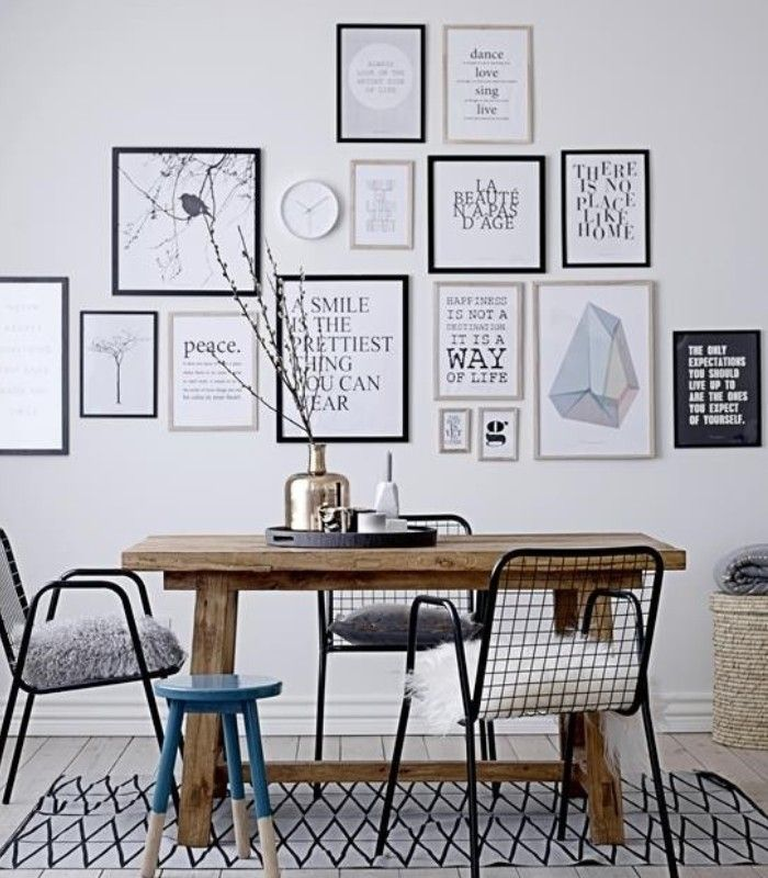 Gallery wall and mismatched chairs scandinavian interiors