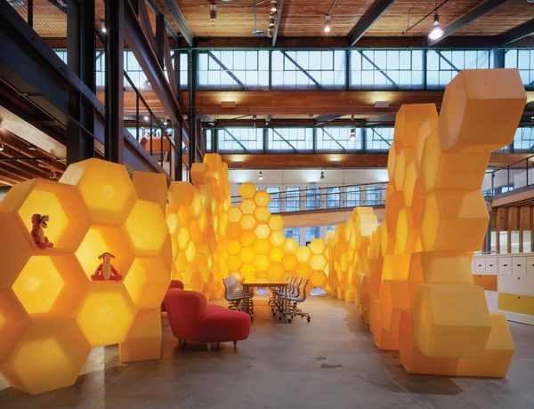modular honeycomb structure, conceived as a flexible means of managing the Disney sample product display, forms a second conference room