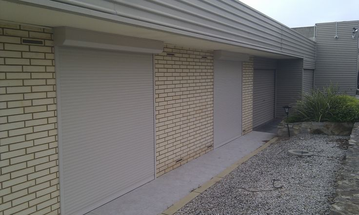 Two brand new shutters installed, from eave to ground.