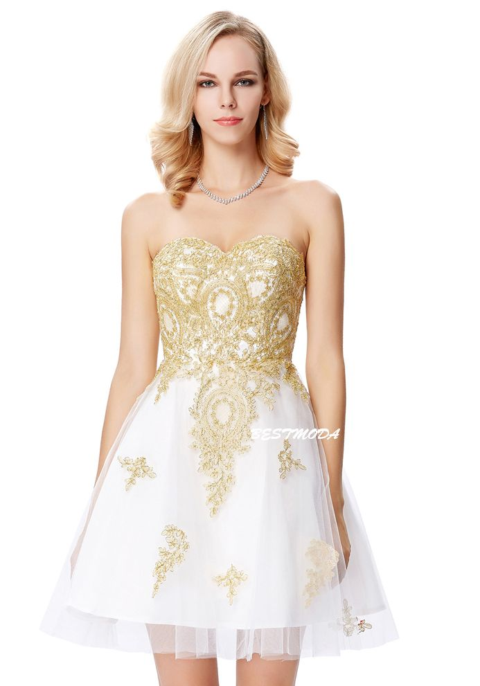 White cocktail dress with golden applique