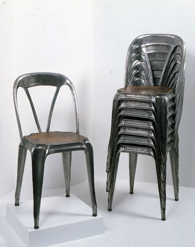 art nouveau stacking metal chair with pressed wooden seat circa via the wolfsonian