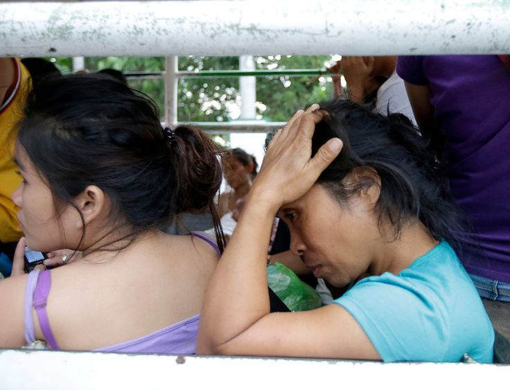 Earthquake victims wait for treatment at a government hospital following a 7.2-magnitude quake that hit Cebu city in central Philippines Tue...