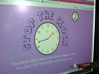 """Stop the Clock"" Telling Time Smartboard game (choose to the half hour, quarter hour, 5 minute, or minute)"