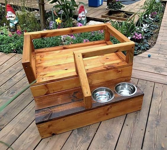 This small pallet wood dog bed is perfect for your little pup. You just need to add a comfy mattress and there you go. The two feeding bowls are attached to the base of the first step. It is good to be kept in small space.