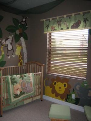 JUNGLE BABY NURSERY THEME with a SAFARI NURSERY WALL MURAL incl MONKEYS, LIONS, GIRAFFES and ELEPHANTS!  My jungle baby nursery theme began to take shape when I fell in love with a set of Nojo Jungle crib bedding.  To paint this playful jungle nursery wall