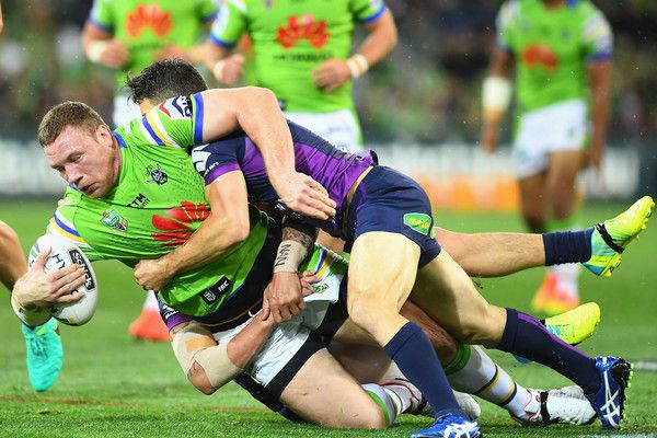 Cooper Cronk Photos Photos - Shannon Boyd of the Raiders is tackled by Cooper Cronk of the Storm during the NRL Preliminary Final match between the Melbourne Storm and the Canberra Raiders at AAMI Park on September 24, 2016 in Melbourne, Australia. - NRL Preliminary Final - Melbourne v Canberra