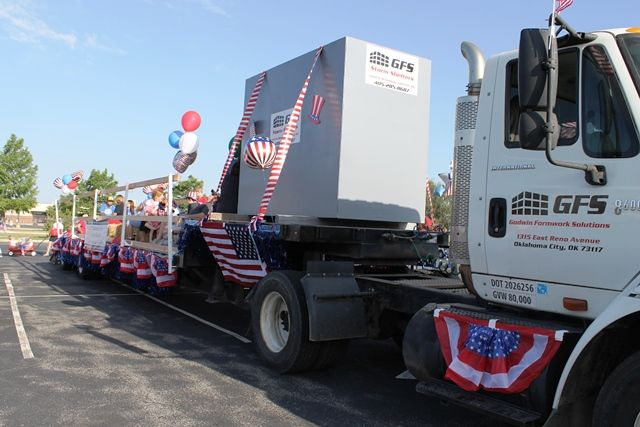 The GFS semi towing one of our storm shelters and the rest of our parade float!