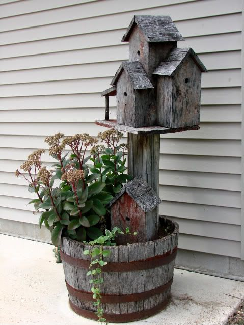 Add an old birdhouse to a planter to create instant charm and height.