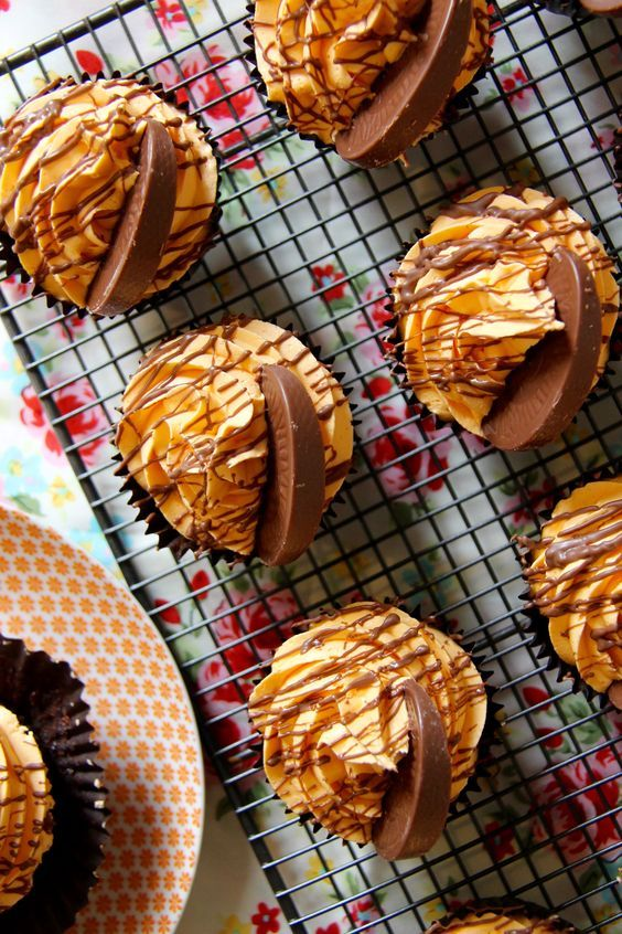 Chocolate Orange Cupcakes - Chocolatey Cupcakes studded with Chunks of Terry's Chocolate Orange, topped with an Orange Buttercream, and even more Chocolate Orange!