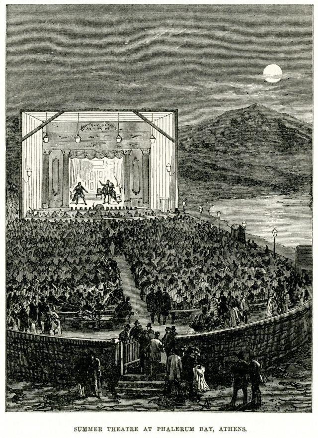 Το δεύτερο Θέατρο Φαλήρου σε χαρακτικό του 1887. Οικοδόμηση: 1881 Κατεδάφιση: 1895 Το δεύτερο θέατρο Φαλήρου κτίστηκε πάνω στην φαληρική ακτή, δίπλα στο κύμα. (Εκεί που είναι σήμερα η οδός Εθνάρχου Μακαρίου, στο ύψος περίπου της οδού Ζερβού.  Στο θέατρο αυτό, ουσιαστικά, μόνο η σκηνή ήταν κτισμένη. Διακρίνονται τα σπετσάτα στα δύο άκρα της μπούκας. Στο προσκήνιο τα φώτα της ράμπας και το κουβούκλιο του υποβολέα. Κάτω από το παλκοσένικο φαίνεται η ορχήστρα. Πίσω βλέπουμε το φεγγάρι να…