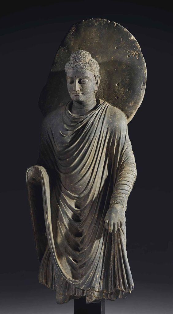 AN IMPORTANT GREY SCHIST FIGURE OF BUDDHA SHAKYAMUNI - GANDHARA REGION, 2ND-3RD CENTURY.