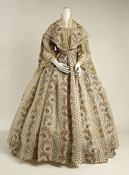 A French cotton dress from around 1850. Though the pattern and lace trim are busy, the lightness of the fabric seems more comfortable to me than many of the wool and silk dresses I've seen from the period.