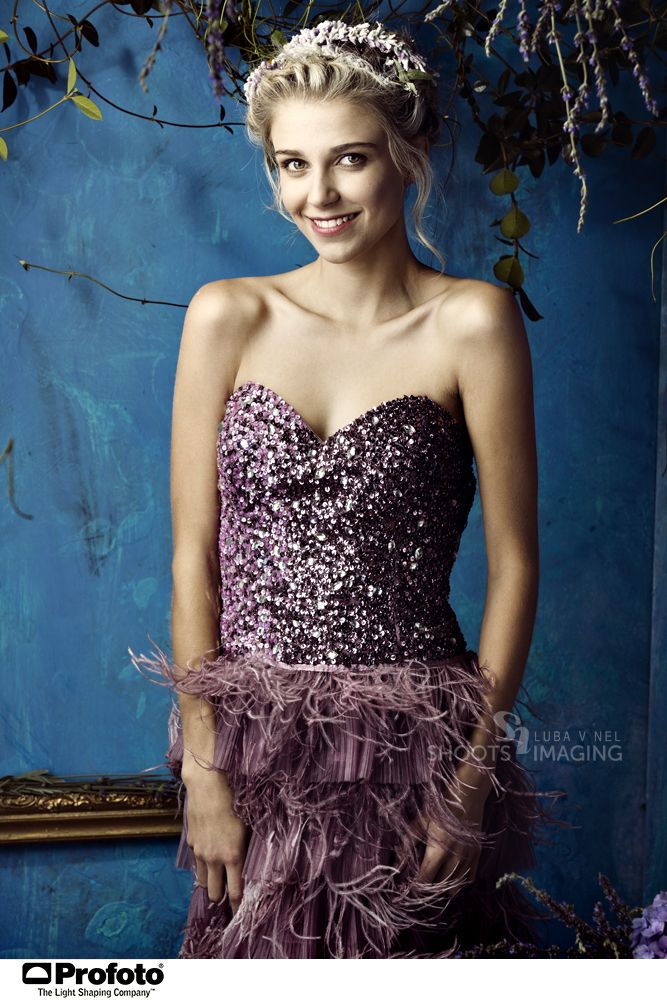 glitter dress by Vintage Vices against painted blue studio background. Lookbook shoot by Luba V Nel