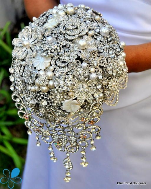 This is the most beautiful broach bouquet i have ever seen Love the way this cascades off the lower section!