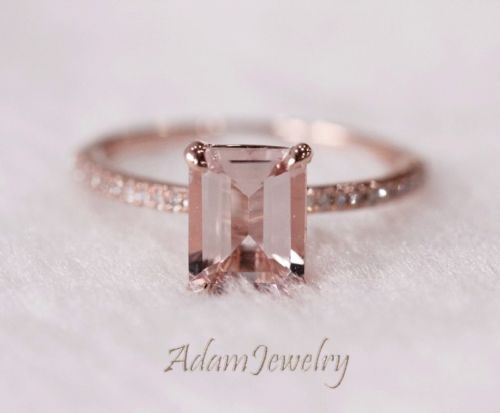 Emerald cut pink ring.