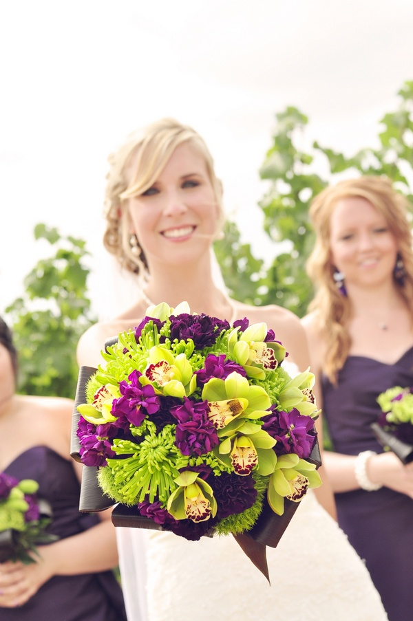 purple flowers with green cymbidium orchids bridal wedding bouquet