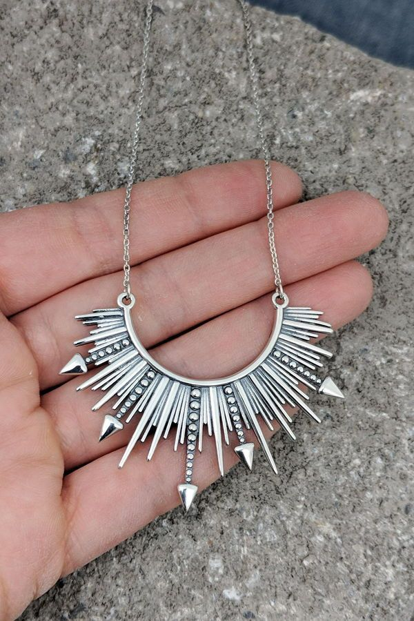 d89e852ec This is a sterling silver necklace in a bursting starburst design. It hits  just below the collarbone, so it's perfect with spring and summer camisoles  and ...