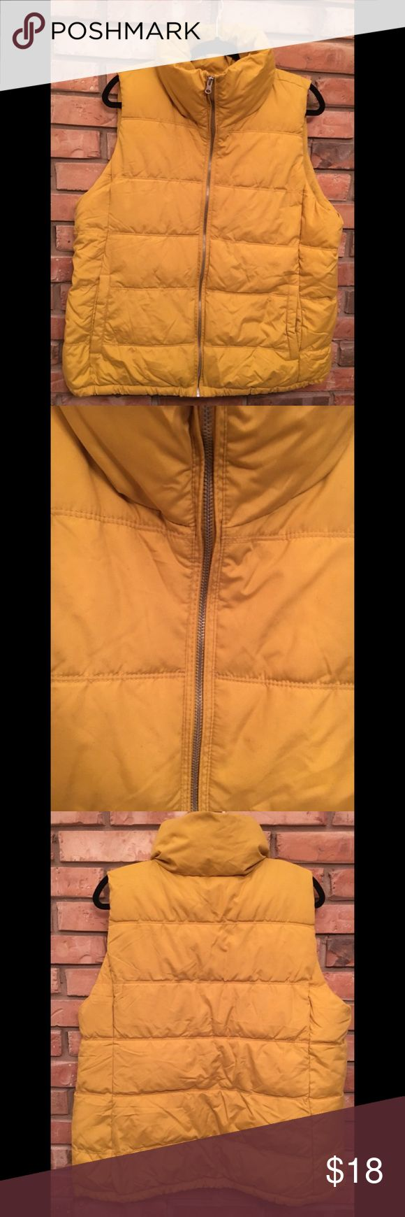 Puffer Vest Mustard yellow puffer vest. NWOT. Too big for me. Silver/grey zipper. Two functional front pockets. Cozy lining inside vest and inside pockets. Old Navy Jackets & Coats Vests
