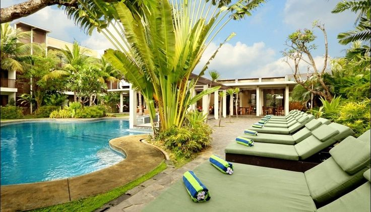 Kokonut Suites bali located in seminyak, surounded by rice fields and palm trees. This peaceful tropical retreat features a free form outdoor pool, a spa, and an open-air restaurant. 12 miles from Ngurah Rai International Airport. Pool with unique shape, resort spa, bar, pool, lounge. This suites near the potato head, seminyak art shopping. http://www.zocko.com/z/JGXLz