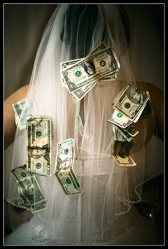 Dollar Dance... to dance with the bride or groom, pin $$ on them and the $$ goes to the bride and groom to use on their honeymoon