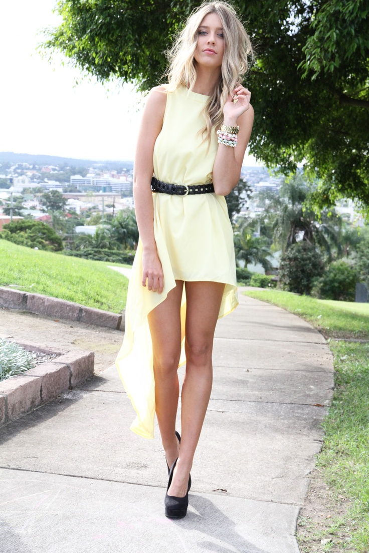 beachy waves, pale yellow high-low maxi, pastel arm candy and black pumps & belt